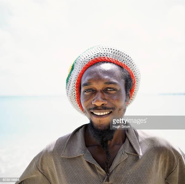 man smiling at the beach - hugh sitton stockfoto's en -beelden