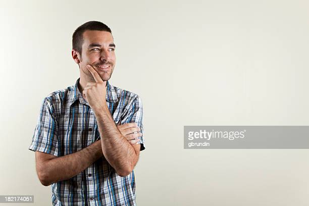 a man smiling because he has an idea - short sleeved stock photos and pictures