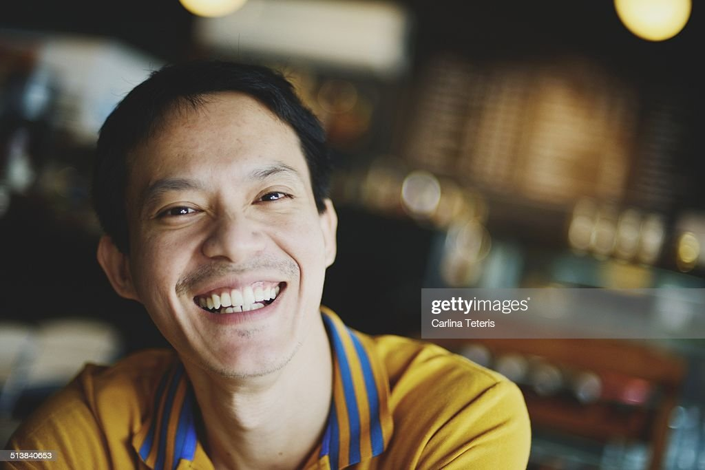 Man smiling in a cafe : Stock Photo