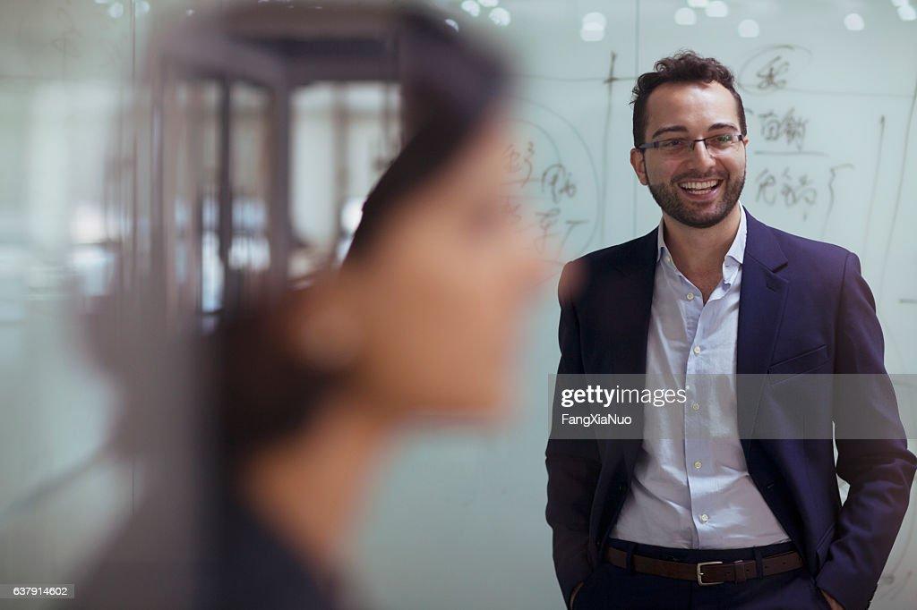 Man smiling in design studio office : Stock Photo