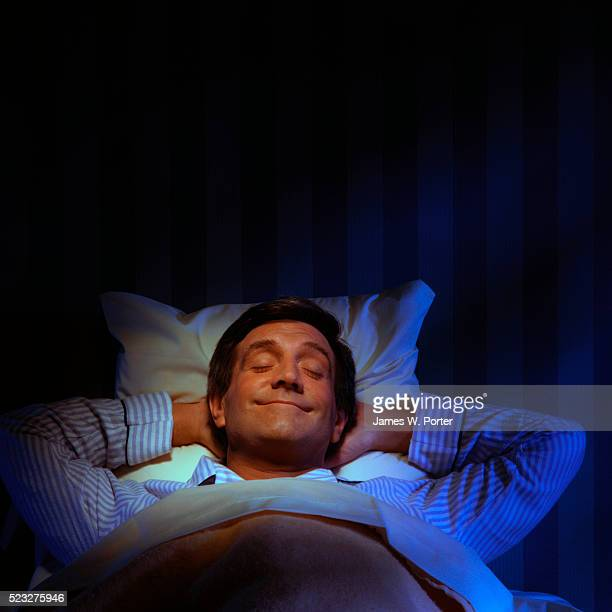 Man Smiling in His Sleep