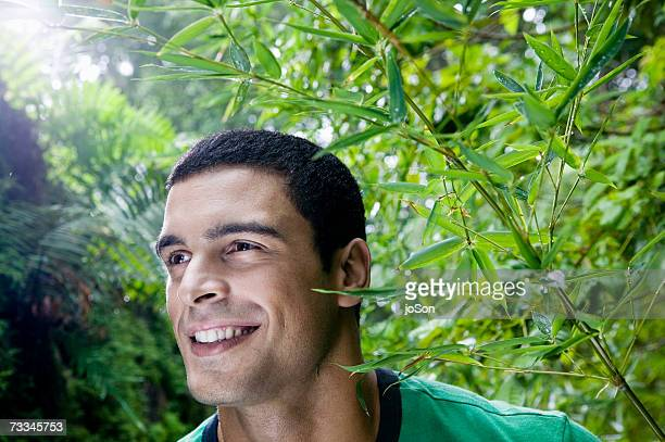 Man smiling in rainforest