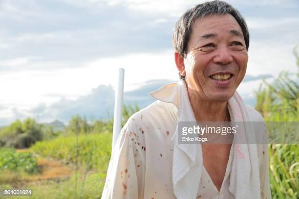 Man smiling in self-made vegetable garden