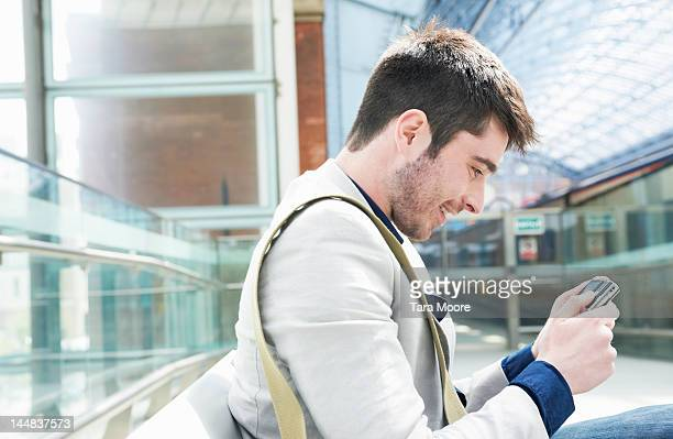 man smiling looking at camera at station - newtechnology stock pictures, royalty-free photos & images
