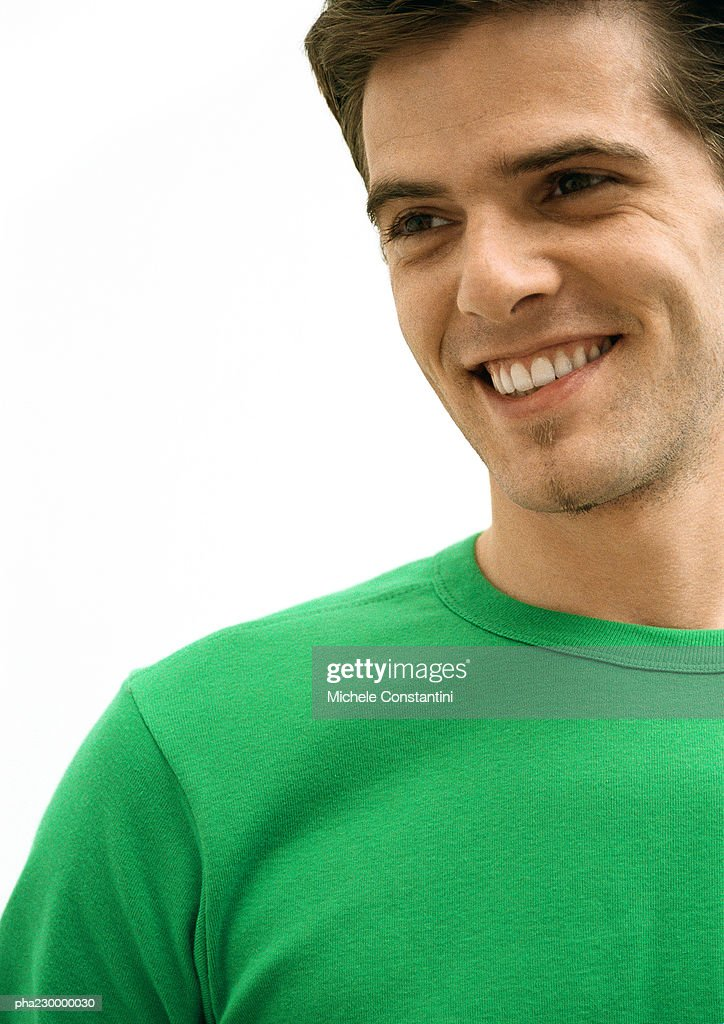 Man smiling looking right, portrait. : Stockfoto