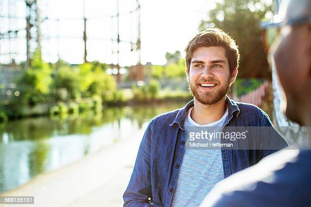 man smiling next to canal - canal stock pictures, royalty-free photos & images