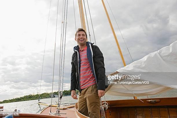 Man smiling on sailboat