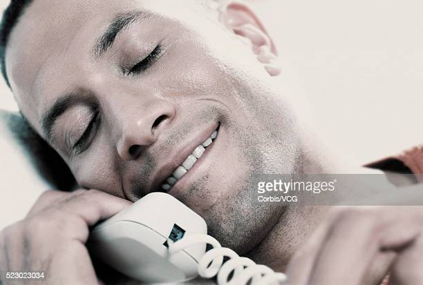 Man Smiling on Telephone