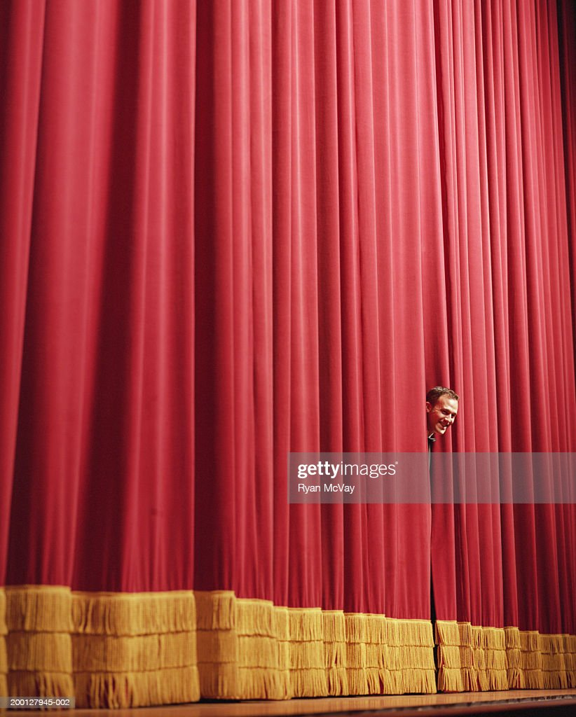Man Smiling Peering Head Between Curtains On Stage Stock Photo ...