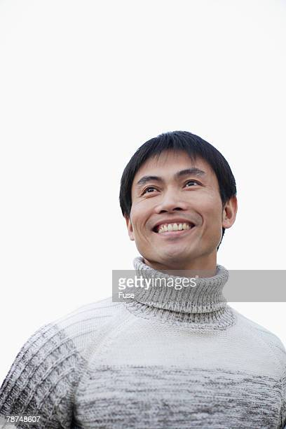 man smiling - turtleneck stock pictures, royalty-free photos & images