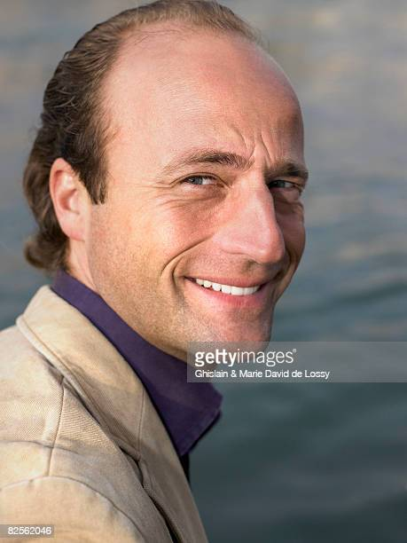 man smiling - mid adult men stock pictures, royalty-free photos & images