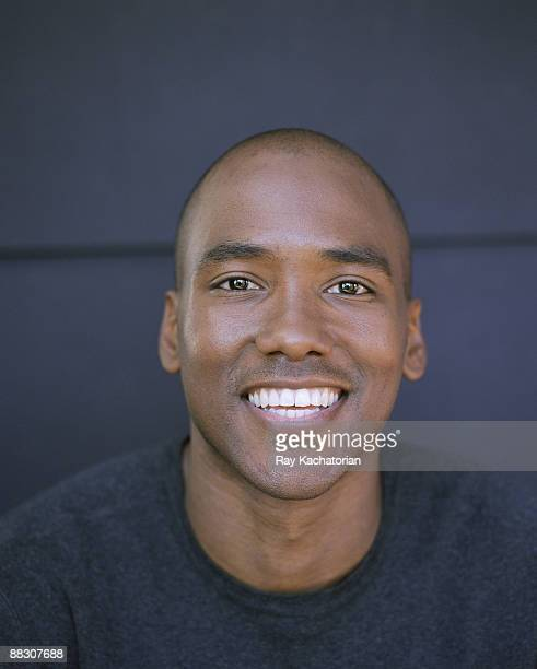 man smiling - mid adult stock pictures, royalty-free photos & images