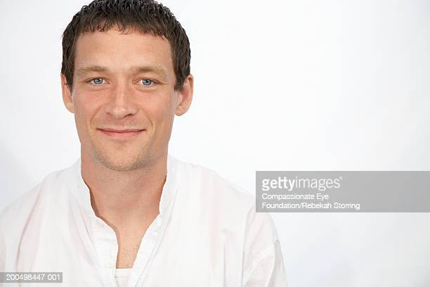 man smiling, portrait - compassionate eye foundation stock pictures, royalty-free photos & images