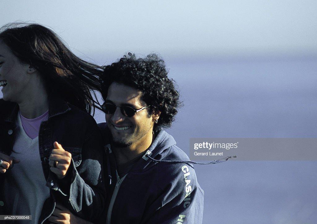 Man smiling pushing woman. : Stockfoto