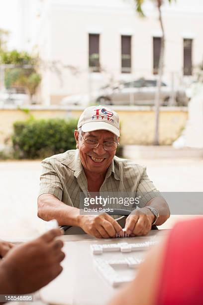 man smiling with dominos - san juan stock pictures, royalty-free photos & images
