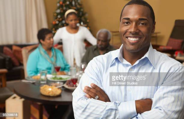 man smiling with family at dinner table in background - gardena california stock pictures, royalty-free photos & images