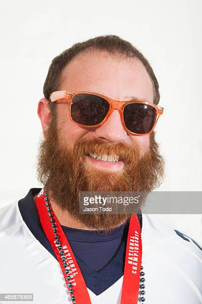 man smiling with glasses,beard and sport jersey - jason todd stock photos and pictures