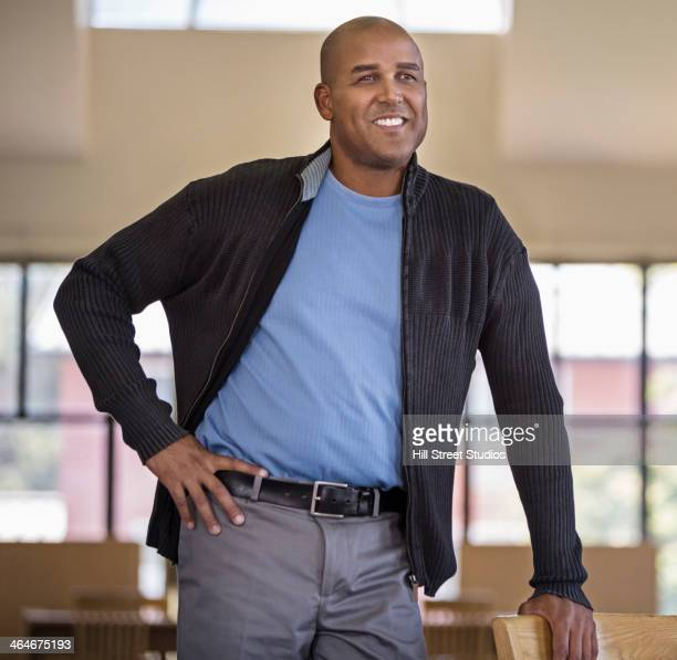 man smiling with hand on hip - caldwell idaho foto e immagini stock
