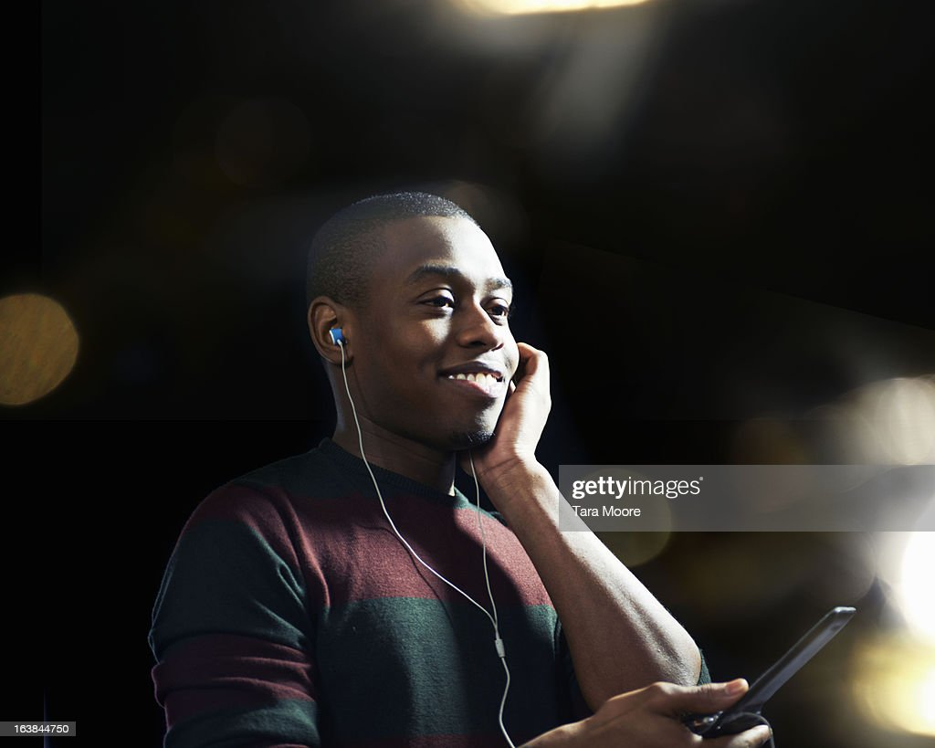 man smiling with headphones and mobile phone : Stock Photo