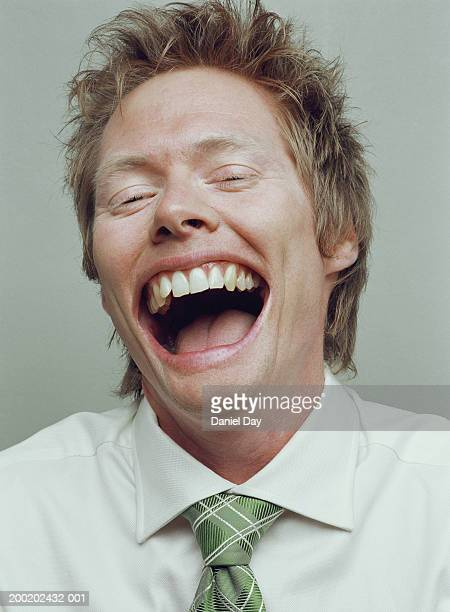 Man smiling with mouth held wide open (Digital Enhancement)