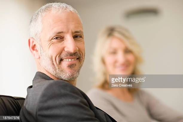 Man smiling with wife