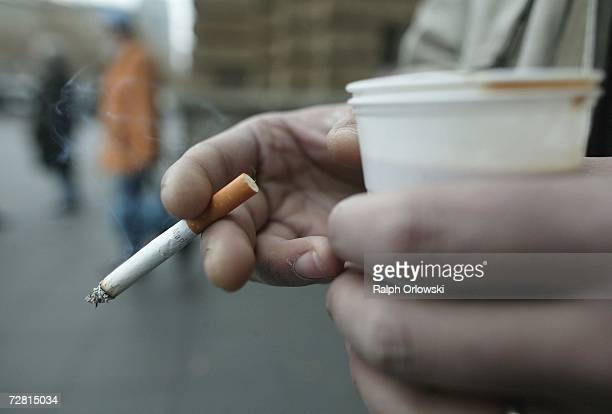 A man smokes a cigarette December 13 2006 in Frankfurt Germany Chancellor Angela Merkel is scheduled to meet with German state governors later in the...