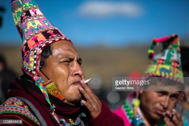 Man smokes a cigarette during a ceremony as part of Killa Raymi celebrations at La Cumbre on September 21, 2020 in La Paz, Bolivia. La cumbre is a...