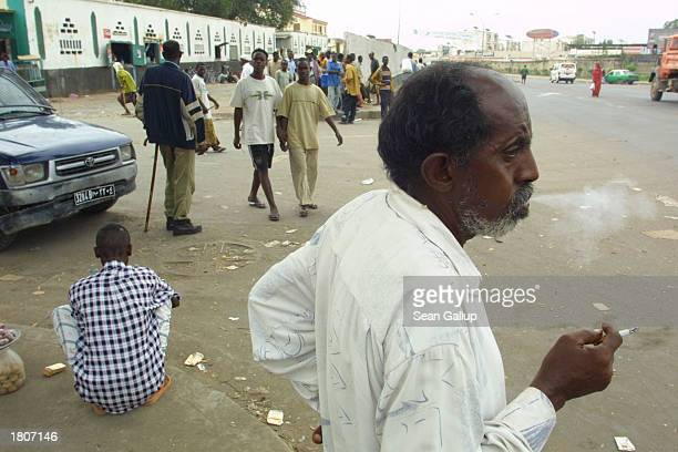 A man smokes a cigarette in the street February 21 2003 in Djibouti Town Djibouti Located in the Horn of Africa Djibouti has taken on strategic...
