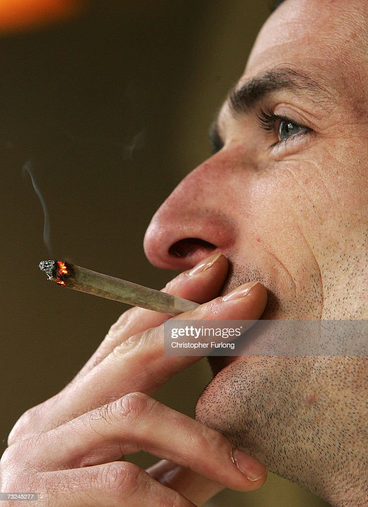 A man smokes a cigarette of marijuana in an Amsterdam cafe on February 7, 2007 in Amsterdam, Netherlands. The city council in Amsterdam has recently voted in favour of introducing a citywide ban on smoking marijuana in public areas. A successful trial ban in the De Baarsjes district of Amsterdam has been declared a success after a reduction in anti social behaviour.