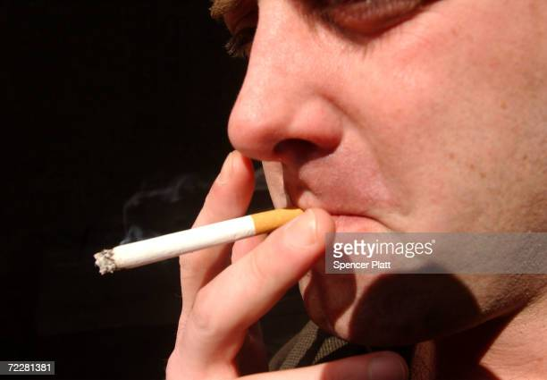 A man smokes a cigarette outside of an office building February 19 2002 in New York City As part of his recent budget plan New York Mayor Michael...