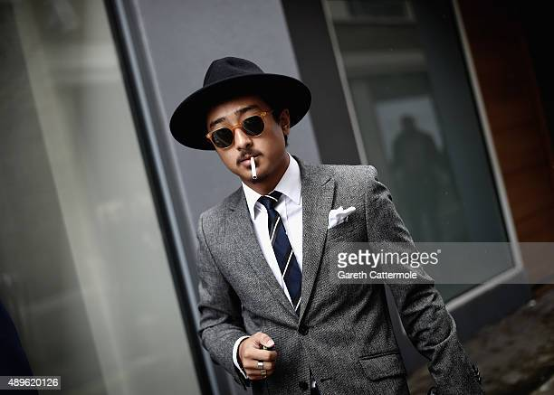 A man smokes a cigarette outside the Brewer Street car park during London Fashion Week Spring/Summer 2016/17 on September 18 2015 in London England