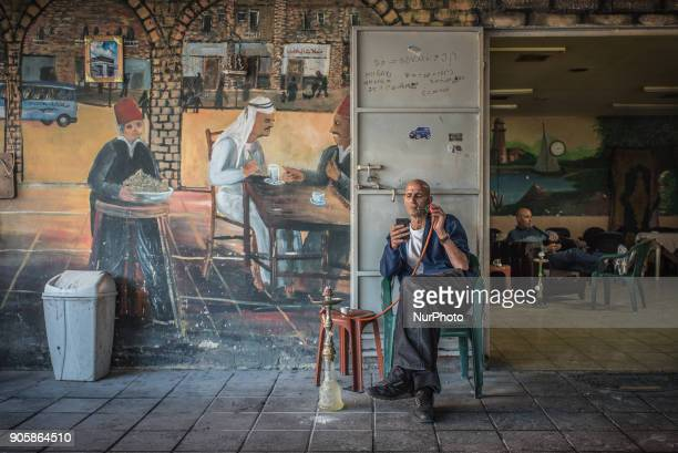 A man smokes a hookah or nargile in a cafe in the Jaffa district of Tel Aviv Israel on 7 January 2018