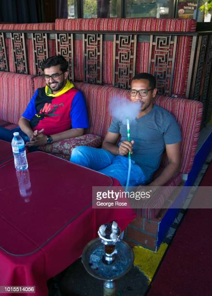 Man smokes a hookah pipe at an outdoor lounge in Westwood Village on August 7, 2018 in Los Angeles, California. Millions of tourists flock to the Los...