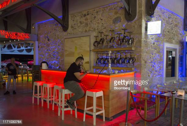 Man smokes a hookah pipe in a bar in Hersonissos, on the island of Crete, Greece, on Tuesday, Sept. 24, 2019. Like Crete, Europes other tourist...