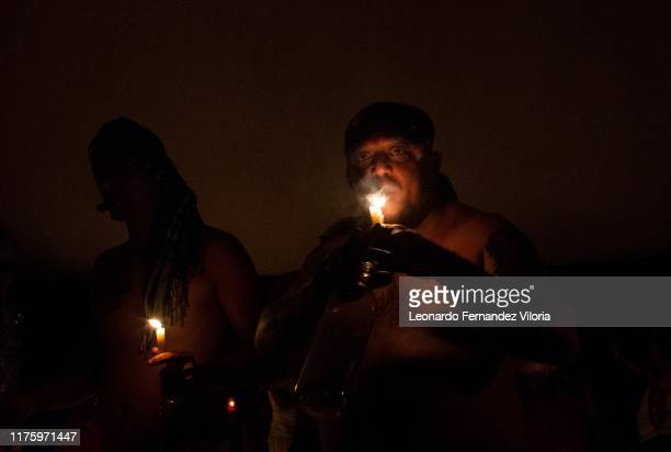 A man smokes a tobacco during a spiritual of called Chamarrers in a portal in the mountain of Maria Lionza at Sorte on October 12 2019 near Chivacoa...