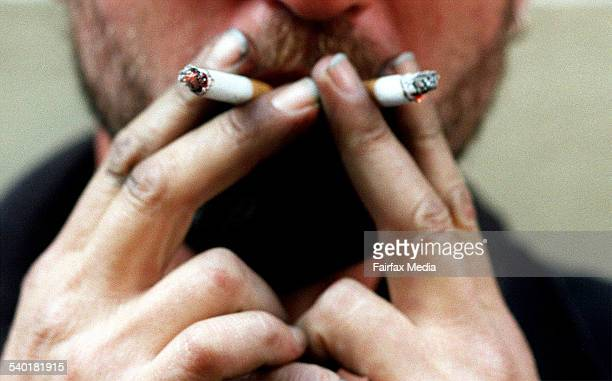 A man smokes cigarettes