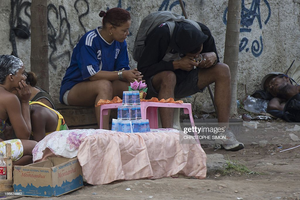 A man smokes crack during a police-municipality joint operation to retire crack addicts from the streets in the vicinity of the Parque Uniao slum in Rio de Janeiro, Brazil, on November 22, 2012. AFP PHOTO/Christophe Simon
