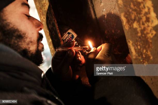 A man smokes crack under a bridge where he lives with other addicts in the Kensington section which has become a hub for heroin use on January 24...