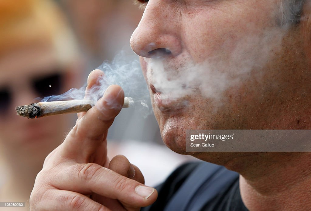 A man smokes licenced medicinal marijuana prior to participating in the annual Hemp Parade, or 'Hanfparade', in support of the legalization of marijuana in Germany on August 7, 2010 in Berlin, Germany. The consumption of cannabis in Germany is legal, though all other aspects, including growing, importing or selling it, are not. However, since the introduction of a new law in 2009, the sale and possession of marijuana for licenced medicinal use is legal.