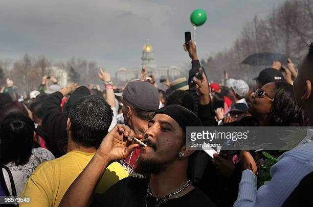 A man smokes marijuana at a propot '4/20' celebration in front of the state capitol building April 20 2010 in Denver Colorado April 20th has become a...