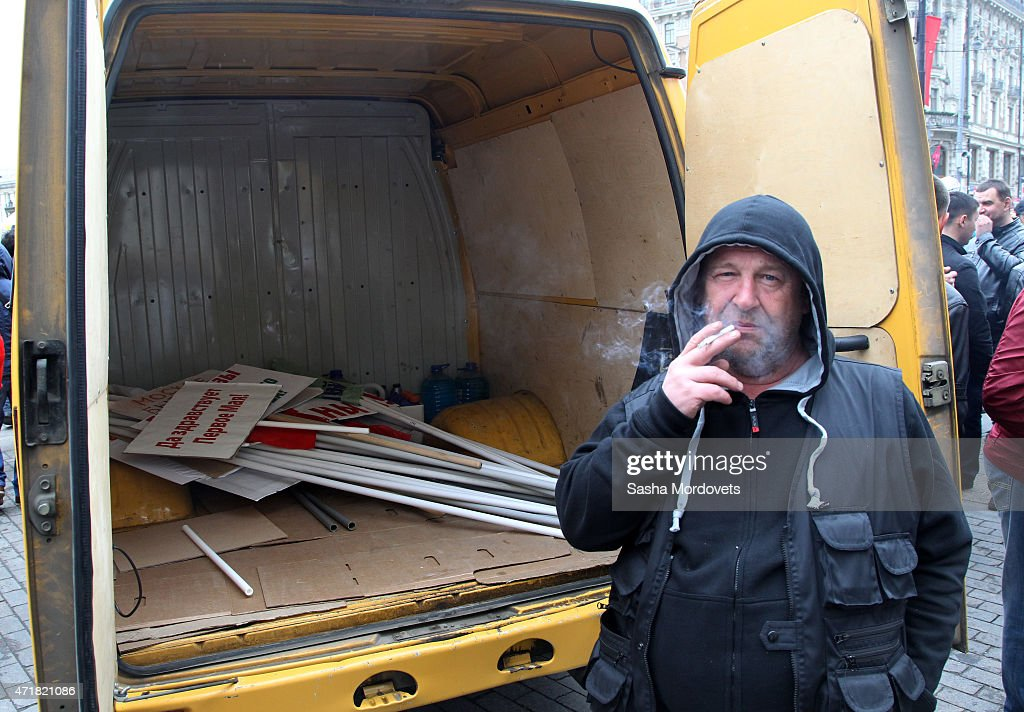 A man smokes near his truck with posters after a Soviet style rally of Russian trade unions on May 1, 2015 in Red Square in Moscow, Russia. Some 140,000 workers and students attended the parade on occasion of Labour Day, also known as International Worker's Day or May Day.