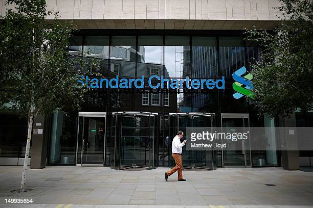 A man smokes outside the Standard Chartered bank's offices on August 7 2012 in London England Standard and Chartered has been accused by American...