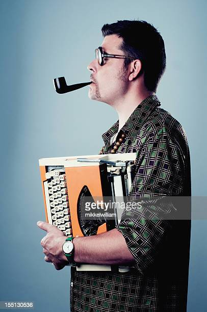 man smokes pipe and holds an old typewriter - poet stock pictures, royalty-free photos & images