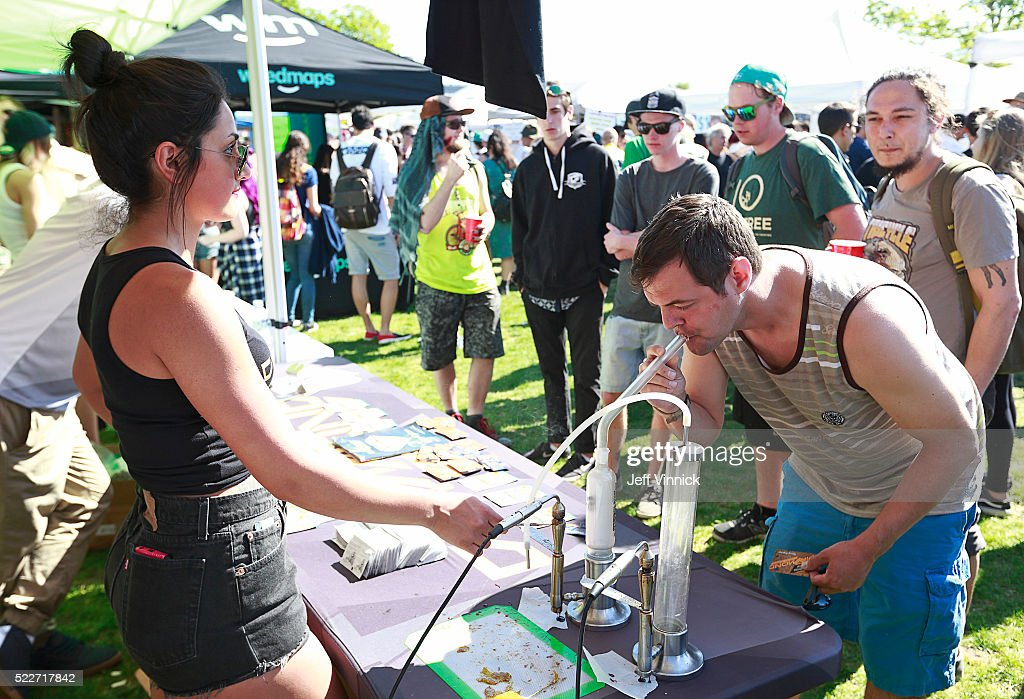 A man smokes shatter from a bong as thousands of people gather at 4/20 celebrations on April 20, 2016 at Sunset Beach in Vancouver, Canada. The Vancouver 4/20 event is the largest free protest festival in the city, with day-long music, public speakers and the world's only open-air public cannabis farmer's market where people sell all kinds of cannabis and extracts while educating the crowd about medical marijuana, political involvement and activism. Canadian Federal Health Minister Jane Philpott says Canada will roll out the legislation in the spring of 2017 to begin the process of legalizing and regulating marijuana.