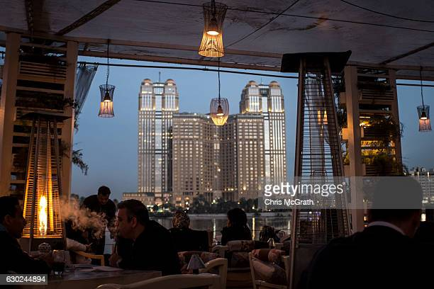 A man smokes shisha at a high end restaurant in the wealthy neighbourhood of Zamelek on December 16 2016 in Cairo Egypt Since the 2011 Arab Spring...
