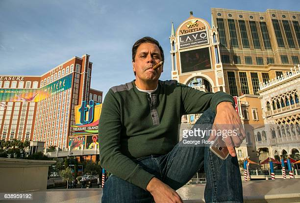 A man smoking a cigar poses for a photo outside the Venetian Hotel Casino on January 3 2017 in Las Vegas Nevada Tourism in America's 'Sin City' has...