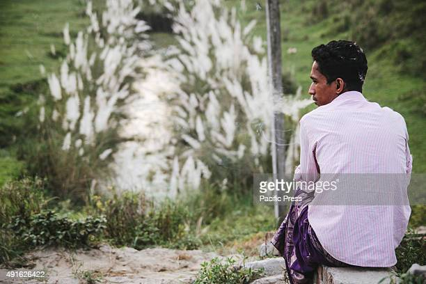 KERANIGANJ DHAKA BANGLADESH A man smoking a cigarette in the afternoon