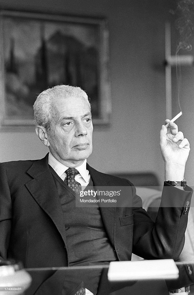 Image result for 1970's man smoking in suit