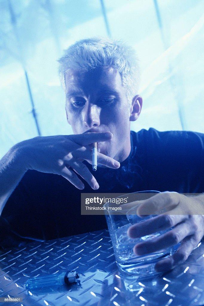 Man smoking and drinking : Stock Photo
