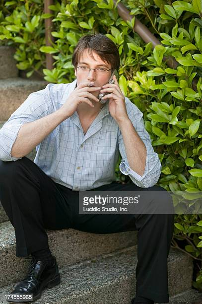 Man smoking and talking on a cellphone